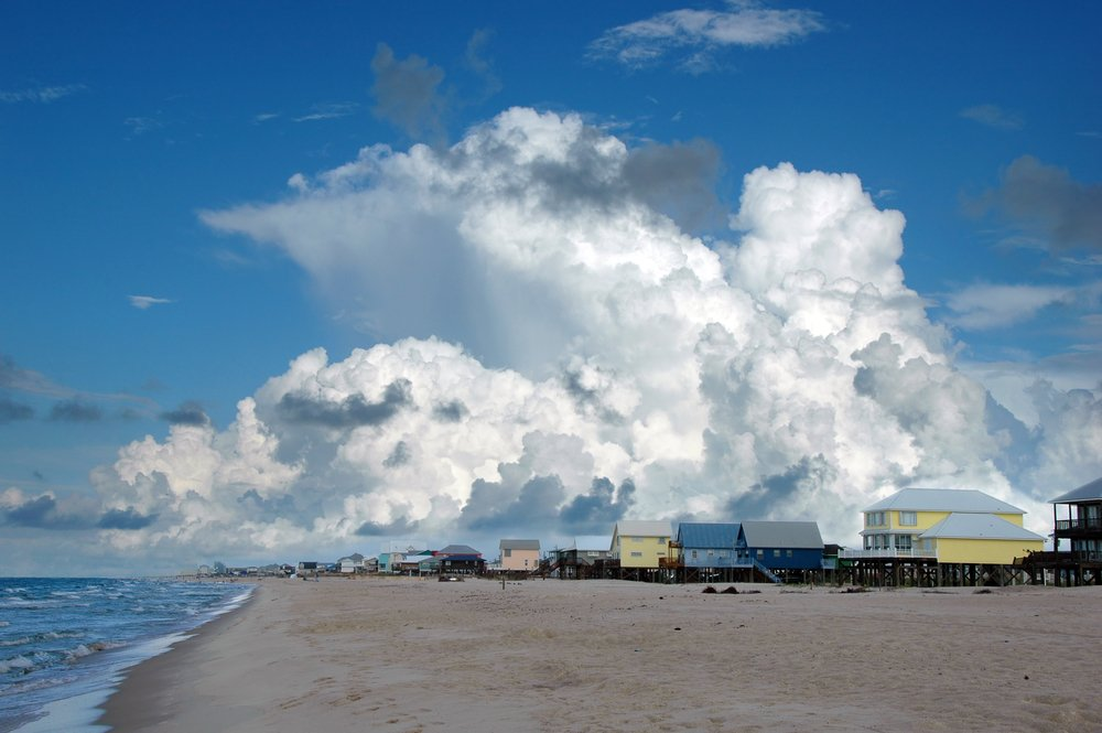 Beach houses in Golf Shores, Alabama; with cumulus clouds in the background