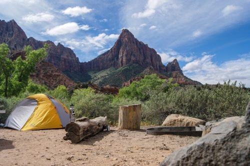 Camping in the desert next to mountains. Camping Calendar