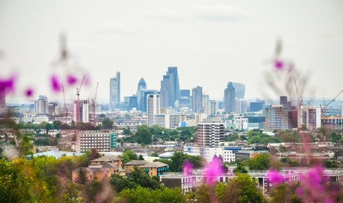 Cityscape from Parliament Hill in Hampsetad Heath park in London, UK