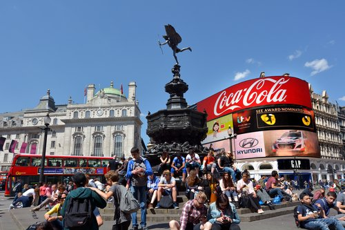 Visitors in Piccadilly Circus London, UK. With nearly 100 million tourists visiting Piccadilly each year it one of the most famous intersections in the entire world